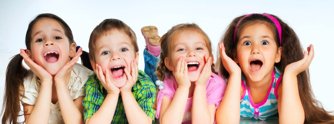 smart-beginnings-four-happy-young-children-laying-up-and-smiling