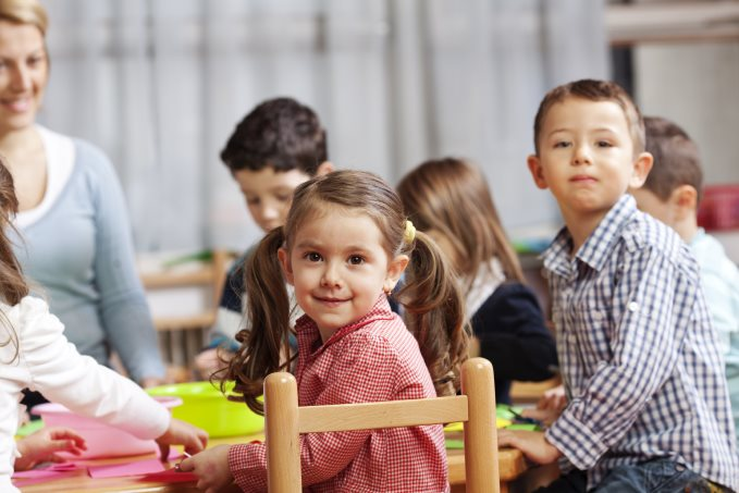 smart-beginnings-young-girl-and-boy-smiling-in-art-class-with-classmates-and-teacher